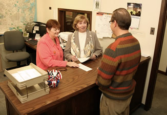 The County Clerk assists a resident