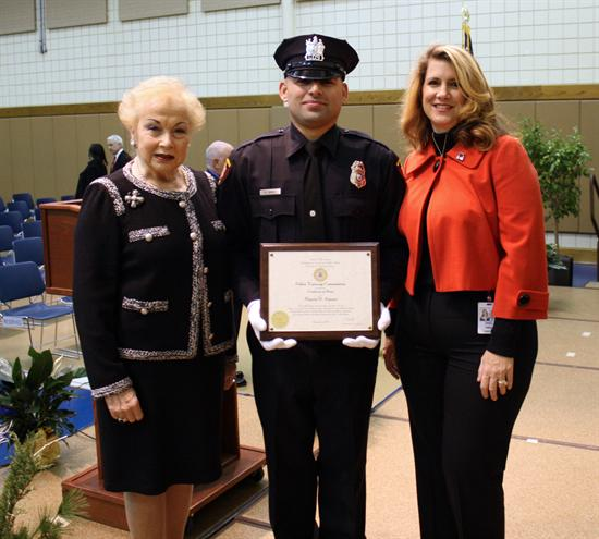 Freeholders Lillian G. Burry and Serena DiMaso with a Monmouth County Police Academy graduate Marcio D. Amaro